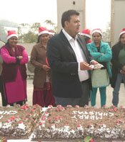 Shamit Khemka with employees in Christmas